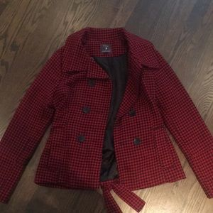 Red and black houndstooth peacoat